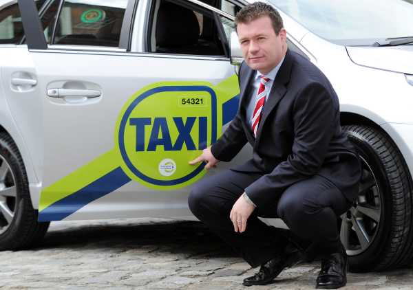 official taxi branding unveiled by Transport Minister Alan Kelly